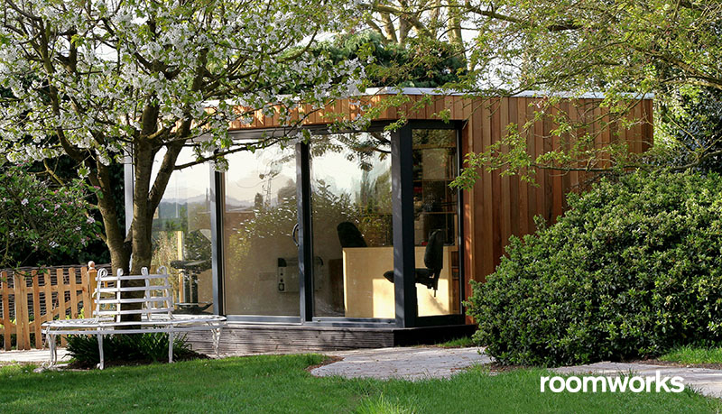 A 5m x 3m garden studio with sliding doors and glazed side panels.